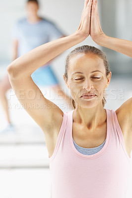Buy stock photo Smiling fit woman practicing yoga with hands joined above head