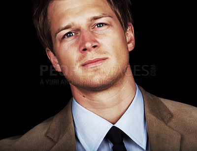 Buy stock photo Confident Male Model A trendy European businessman with a blue tie and shirt. Isolated studio picture on black background. This series is of a professional Danish Model.