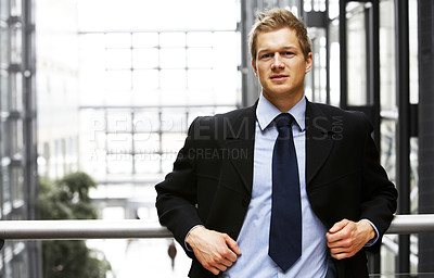 Buy stock photo Businessman smiling - A trendy European businessman with a blue tie and shirt.