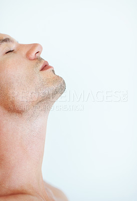 Buy stock photo Closeup of handsome man looking up with eyes closed on - copyspace