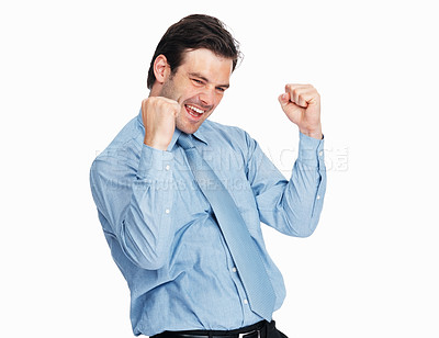 Buy stock photo Portrait of young victorious business man celebrating success with clenched fist over white background