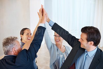 Buy stock photo Portrait of happy business people giving high five to each other