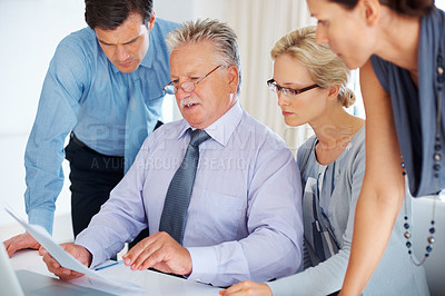 Buy stock photo Group of business people having serious conversation together in office