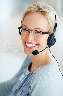 Buy stock photo Portrait of a smiling young woman wearing a headset, working in a call centre
