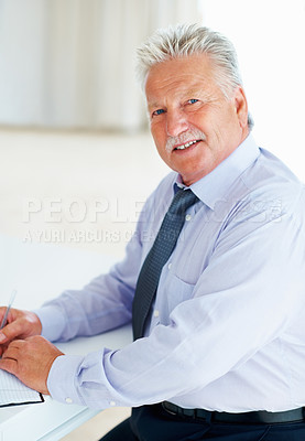 Buy stock photo Portrait of senior business man making checklist for meeting
