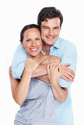 Buy stock photo Portrait of handsome man embracing woman over white background