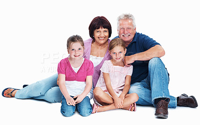 Buy stock photo Full length of happy mature couple sitting with granddaughters on white background