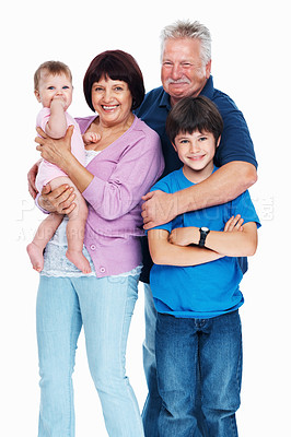 Buy stock photo Loving grandparents embracing their grandchildren while isolated on a white background