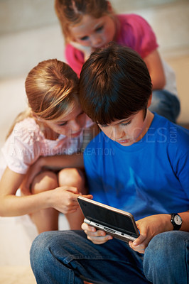 Buy stock photo Portrait of little boy with sisters playing video game