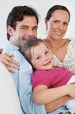 Buy stock photo Portrait of beautiful couple with daughter relaxing on sofa