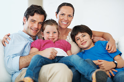 Buy stock photo Portrait of beautiful couple with children relaxing on sofa at home