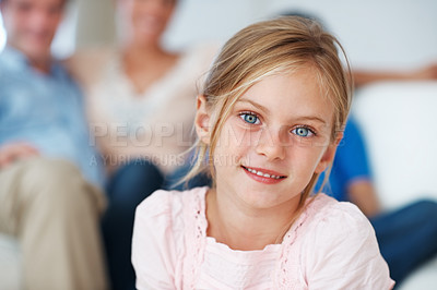 Buy stock photo Closeup portrait of pretty little girl with family relaxing in background