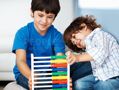 Buy stock photo Portrait of little boy and his brother using an abacus