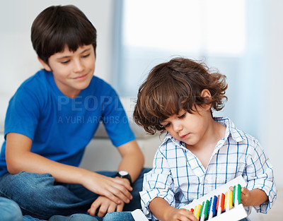 Buy stock photo Cute little boy with brother playing with colorful abacus beads