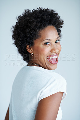 Buy stock photo Laughing African American woman isolated on plain background
