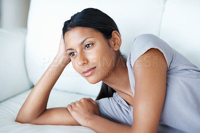 Buy stock photo Thoughtful woman relaxing on couch at home