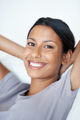 Buy stock photo Closeup of relaxed mixed race woman smiling on couch