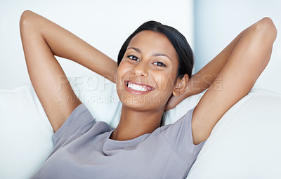 Buy stock photo Closeup of smiling mixed race woman resting at home