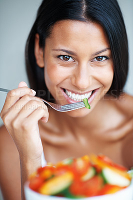 Buy stock photo Portrait of happy mixed race woman eating healthy salad