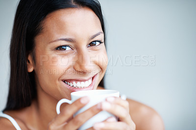 Buy stock photo Closeup of happy mixed race woman having coffee
