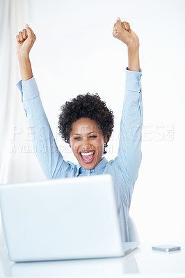 Buy stock photo Excited African American business woman with arms raised looking at laptop