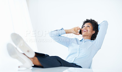 Buy stock photo Relaxed African American business woman using cellphone with legs on desk