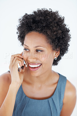 Buy stock photo Portrait of excited African American woman talking on mobile phone over white background