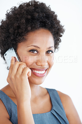 Buy stock photo Portrait of beautiful African American woman talking on mobile phone over white background