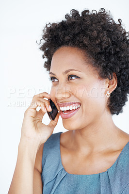 Buy stock photo Closeup of cheerful female executive smiling while talking on mobile phone over white background