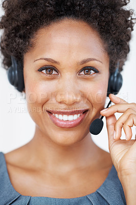 Buy stock photo Closeup portrait of young female customer service representative with headset smiling