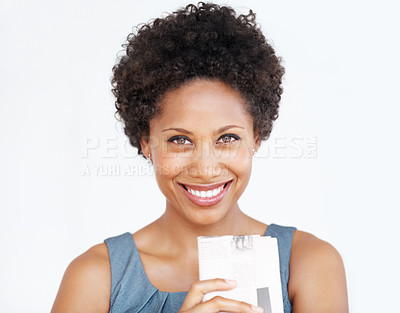 Buy stock photo Attractive business woman smiling holding newspaper over white background
