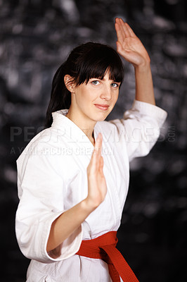 Buy stock photo Portrait of a young woman practicing karate in her gi