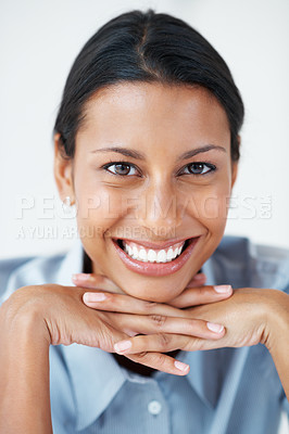 Buy stock photo Portrait of happy female executive smiling over white background with hands on chin