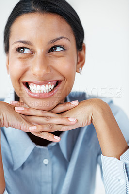 Buy stock photo Closeup of excited business woman sitting with hands on chin