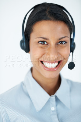 Buy stock photo Portrait of young female customer service representative smiling over white background