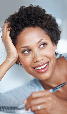 Buy stock photo Closeup of beautiful African American woman thinking while writing in diary