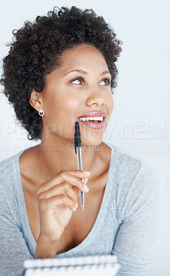 Buy stock photo Thoughtful African American woman thinking while writing in notepad