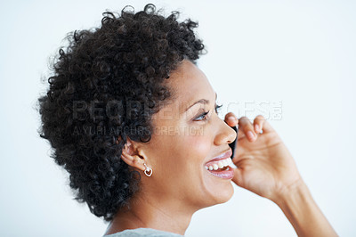 Buy stock photo Closeup of cheerful African American woman talking on mobile phone over white background