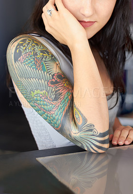 Buy stock photo Cropped shot of a young tattoo artist showing off her half-sleeve tattoo