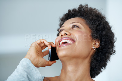 Buy stock photo Closeup of beautiful African American woman laughing while talking on cellphone