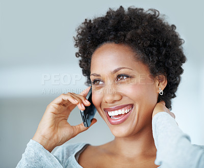 Buy stock photo Closeup of attractive African American woman laughing while talking cellphone