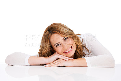 Buy stock photo A stunning young woman lying down upon a white floor and smiling beautifully