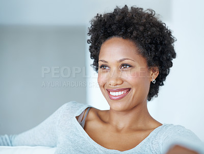 Buy stock photo Closeup of attractive young woman thinking while sitting on couch