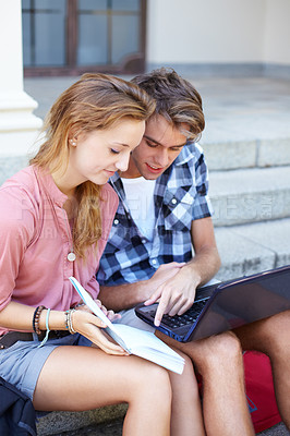 Buy stock photo Young teens going over some work before a big test at university