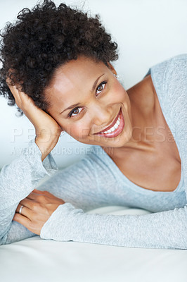 Buy stock photo Portrait of beautiful young woman smiling while resting on couch