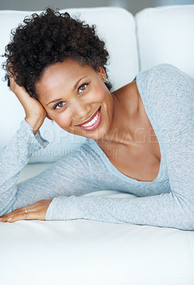 Buy stock photo Portrait of charming young woman on couch looking at you