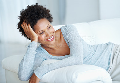 Buy stock photo Beautiful young woman relaxing on comfortable sofa looking away