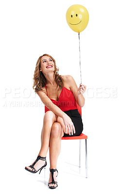 Buy stock photo A pretty woman holding a balloon with a smiley face on it