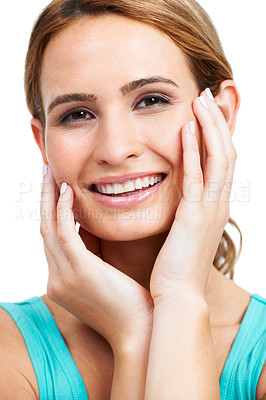 Buy stock photo A gorgeous young woman stroking her smooth, glowing cheeks happily