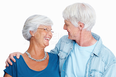 Buy stock photo Shot of a loving senior couple facing each other against a white background